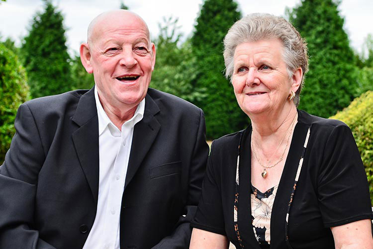 An older couple smiling.